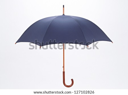 Umbrella isolated over white - stock photo