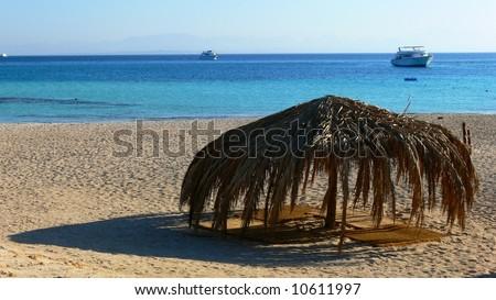 Umbrella on a beach, Giftun Island, Egypt - stock photo