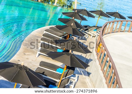 Umbrella pool chair deck
