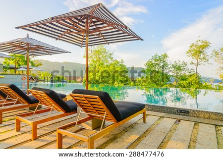 Umbrella pool chair on roof top