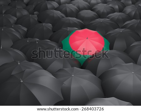 Umbrella with flag of bangladesh over black umbrellas - stock photo