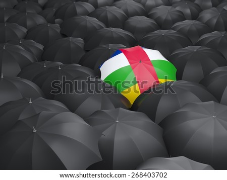 Umbrella with flag of central african republic over black umbrellas - stock photo