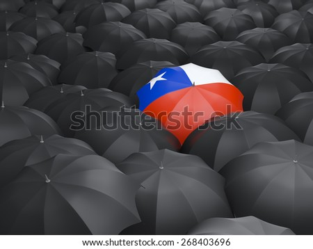Umbrella with flag of chile over black umbrellas - stock photo