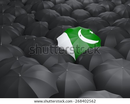 Umbrella with flag of pakistan over black umbrellas - stock photo