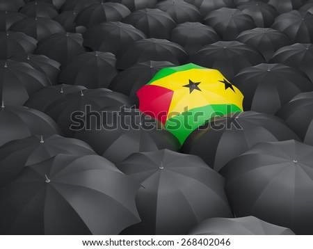 Umbrella with flag of sao tome and principe over black umbrellas - stock photo