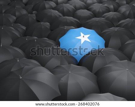 Umbrella with flag of somalia over black umbrellas - stock photo