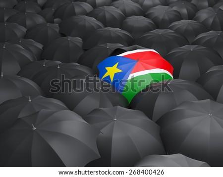 Umbrella with flag of south sudan over black umbrellas - stock photo