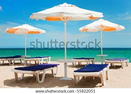 Umbrellas and chairs on beautiful tropical beach