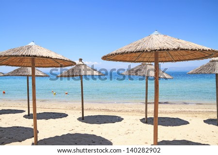 Umbrellas by the sea on exotic resort, Thassos island - Greece