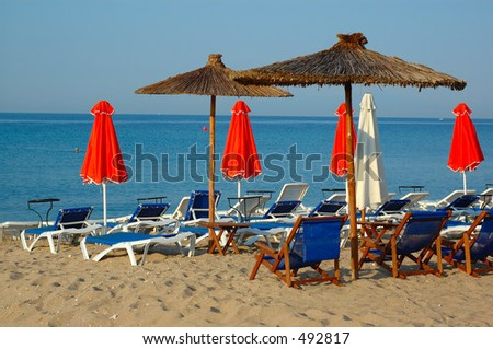 Umbrellas from the Beach Bar - stock photo