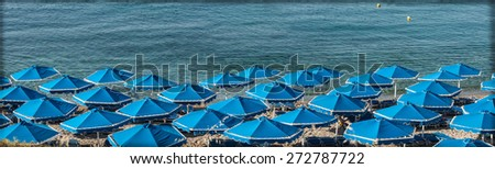umbrellas on the beach near the sea - stock photo