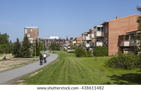 UMEA, SWEDEN ON JUNE 02. View of a modern urban living close to the center on June 02, 2016 in Umea, Sweden. Apartments, Academy of Fine Arts, park, walkway and sunshine.  - stock photo
