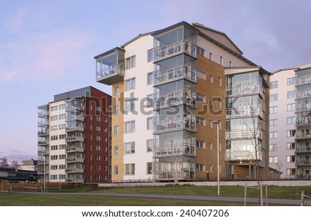 UMEA, SWEDEN ON NOVEMBER 15. Block of modern and newly built apartments on November 15, 2011 in Umea, Sweden. View of  flats in evening lit.