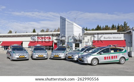 UMEA, SWEDEN ON SEPTEMBER 13. Five new Toyota Prius Plus this side the local reseller of Toyota on September 13, 2012 in Umea, Sweden. Eco Taxi, a local partner on 911911 for a cab. - stock photo