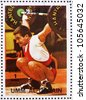 UMM AL-QUWAIN - CIRCA 1972: a stamp printed in the Umm al-Quwain shows Weightlifting, Gymnastics, Summer Olympics, Munich 1972, circa 1972 - stock photo