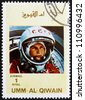 UMM AL-QUWAIN - CIRCA 1972: a stamp printed in the Umm al-Quwain shows Yuri A. Gagarin, Astronaut, the First Human into Outer Space, circa 1972 - stock photo