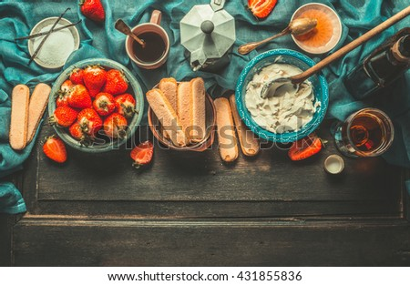 Unadulterated italian strawberry tiramisu cooking ingredients on dark rustic kitchen table, top view, place for text. Italian food concept, border - stock photo