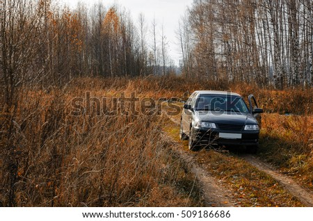 unattended abandoned car in the woods on the nature