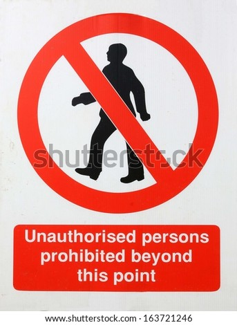 Unauthorised persons prohibited beyond this point sign.  - stock photo