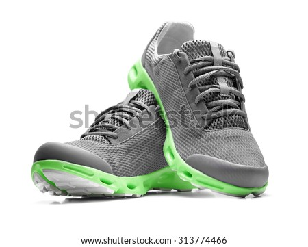 Unbranded modern sneakers isolated on a white background. - stock photo