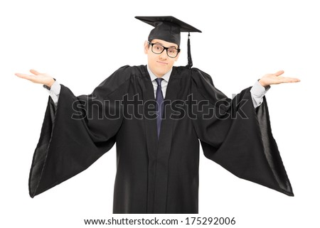 Uncertain student in graduation gown gesturing with hands isolated on white background - stock photo