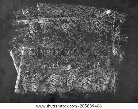 Unclean empty old blackboard with chalk stains - stock photo