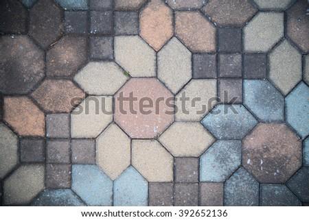 Unclean flower shape brick floor - top view - stock photo