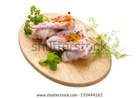 Uncoocked chicken with herbs