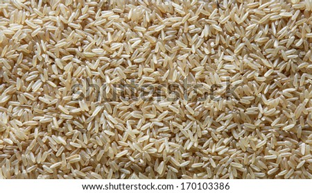Uncooked Brown rice background - stock photo