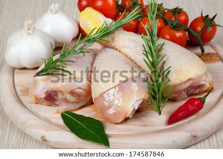 uncooked chicken thigh -raw - chicken with vegetables - stock photo
