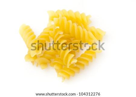 Uncooked dry Italian rotini pasta - stock photo