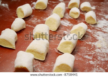 Uncooked dumplings on the table - stock photo