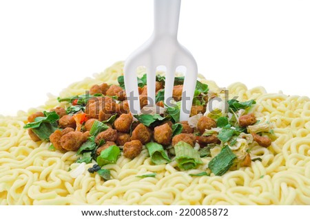Uncooked fast food vermicelli with fork  - stock photo