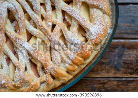 Uncooked homemade rustic apple pie preparation greased with egg  - stock photo