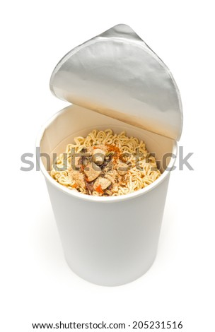 uncooked instant cup noodle with ingredient on white background - stock photo