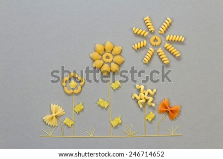 Uncooked italian pasta in floral shapes on background - stock photo