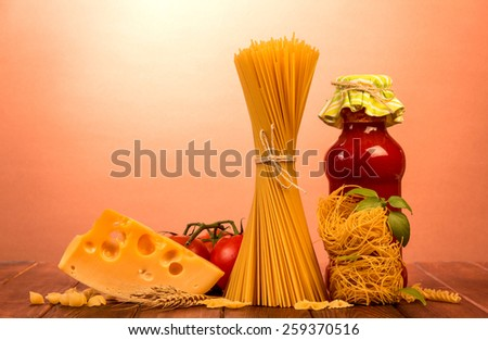 Uncooked italian pasta with vegetables and cheese - stock photo