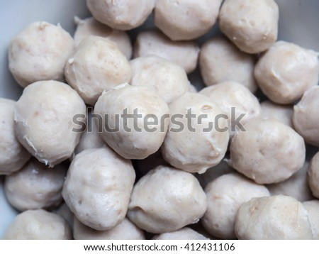 Uncooked meatball prepare for make a chinese noodle, selective focus - stock photo
