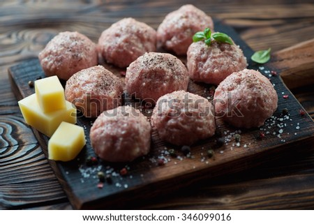 Uncooked meatballs with seasonings, selective focus, studio shot - stock photo