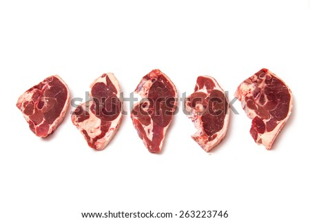 Uncooked New Zealand lamb chops isolated on a white studio background. - stock photo