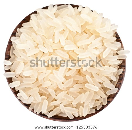 Uncooked rice in a wooden bowl on a white background. Clipping path. - stock photo
