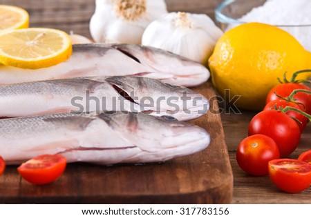 Uncooked sea bass.  - stock photo