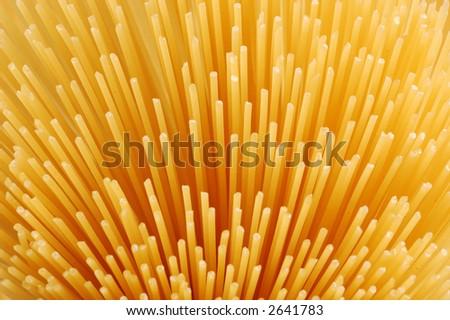 uncooked spaghettis background - stock photo