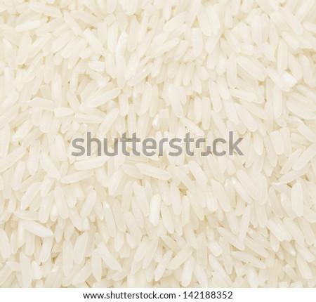 Uncooked white rice close up - stock photo