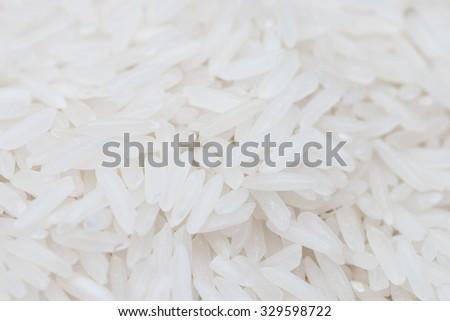 Uncooked white rice (Jasmine Rice). - stock photo