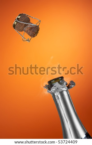 uncorked bottle of champagne on a bright background