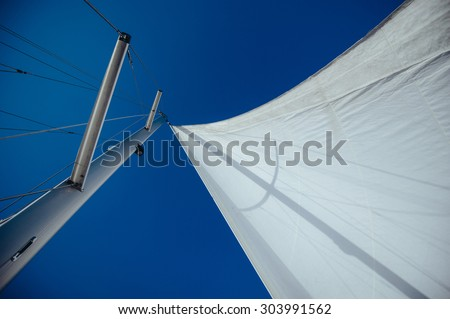 Uncover the wind sail, mast and rigging - stock photo