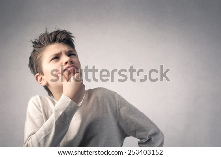 Undecided boy  - stock photo