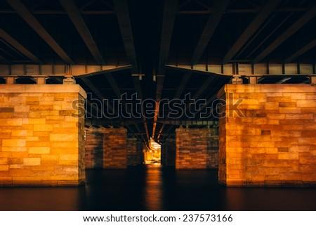 Under a bridge at night, in Washington, DC. - stock photo