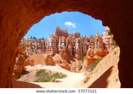 Under a walking arch in Bryce Canyon National Park, UT - stock photo